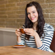 Woman in Coffee Shop Holding Cup — Stock Photo