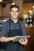 Happy Owner Holding Digital Tablet In Cafe — Stock Photo