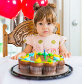 Girl Sitting In Front Of Birthday Cake — Stock Photo