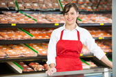 Beautiful Saleswoman Standing At Counter In Butcher's Shop — Stock Photo