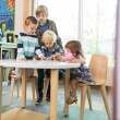 Children Using Digital Tablet In Library — Stock Photo