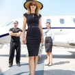 Beautiful WomWith Bodyguard And Airhostess Against Private Pl — Stock Photo #36758853