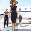 Beautiful Woman With Bodyguard And Airhostess Against Private Pl — Stock Photo