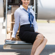 Airhostess Sitting On Ladder Of Private Jet — Stock Photo