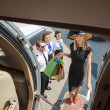 Portrait Of Rich Woman With Shopping Bags Boarding Private Jet — Stock Photo