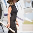 Woman Smiling While Disembarking Private Jet — Stock Photo