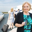 Confident Businesswoman Against Private Jet — Stockfoto