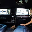 Woman In Limousine At Airport Terminal — Stock Photo