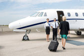 Businesswoman With Luggage Walking Towards Private Jet — Stock Photo