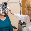 Stock Photo: OpticiExamining Patient's Vision