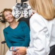 Stock Photo: Happy Senior WomUndergoing Eye Checkup