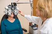Optician Examining Patient's Vision — Stock Photo