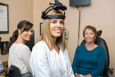 Optometrists With Senior Patient In Store — Stock Photo