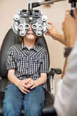 Boy Undergoing Eye Examination With Phoropter — Stock Photo