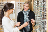 Salesgirl And Customer Holding Glasses In Shop — Stock Photo
