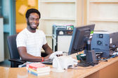 Male Librarian Working At Desk — Stock Photo