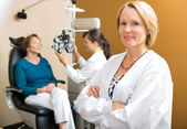 Confident Ophthalmologist With Colleague Examining Patient — Stock Photo