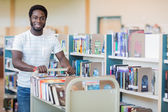 Librarian With Trolley Of Books In Bookstore — Stock Photo