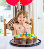 Happy Girl Sitting In Front Of Birthday Cake — Stock Photo