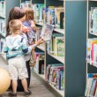 Teacher With Children Selecting Book In Library — Stock Photo #37422045
