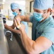 Stock Photo: Sterilizing Hands and Arms Before Surgery