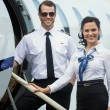 Happy Airhostess And Pilot Standing On Private Jet's Ladder — Stock Photo #37452695