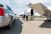 Airhostess And Pilot Standing Neat Limousine And Private Jet — Stock Photo