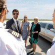 Stock Photo: Business Professionals Greeting Pilot And Airhostess At Airport