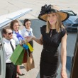 Smiling Rich Woman With Shopping Bags Boarding Private Jet — Stock Photo