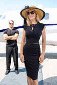 Happy Woman Against Bodyguard And Private Jet — Stock Photo