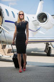 Wealthy Woman With Luggage Walking Against Private Jet — Stock Photo