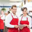 Butchers With Digital Tablet Standing In Store — Stock Photo #38326051