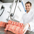 Male Butcher Cutting Meat On Bandsaw — Stock Photo #38326071