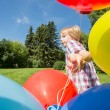Boy With Balloons Running In Park — Stock Photo
