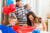 Family Opening Birthday Present At Home — Foto Stock