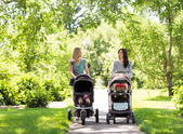 Mothers With Baby Carriages Walking In Park — Stock Photo