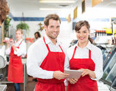Butchers With Digital Tablet Standing In Store — Stock Photo
