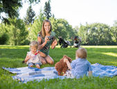 Mother Photographing Children In Park — Stock Photo