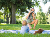 Mother Photographing Baby Boy At Park — Stock Photo