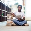 Foto Stock: Student With Books And Digital Tablet Sitting In Library