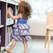 Girl Choosing Book From School Library — Stock Photo