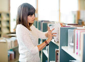 Student Selecting Books In Bookstore — Stock Photo