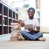 Student With Books And Digital Tablet Sitting In Library — Stock Photo