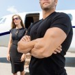Bodyguard Standing Against WomAnd Private Jet — Stock Photo #38472003