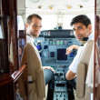 Pilots In Corporate Plane Cockpit — Stock Photo