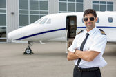 Pilot With Arms Crossed Standing In Front Of Private Jet — Stock Photo