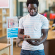 Student Using Digital Tablet In Library — Stock Photo