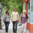 Smiling Friends Walking On Pavement — Stock Photo