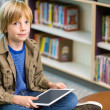Boy With Digital Tablet In Library — Stock Photo