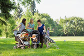 Mothers With Baby Strollers Reading Text Message — Stock Photo